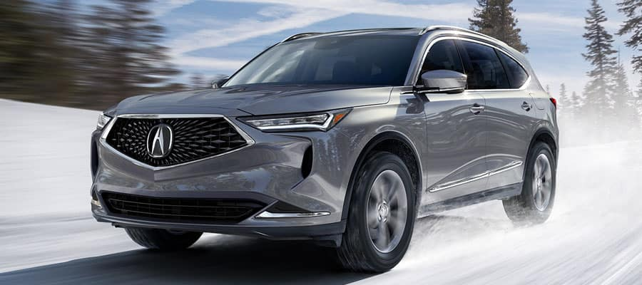 Silver 2022 Acura MDX Driving on a Snowy Road