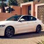 Alfa Romeo Giulia Parked Outside House Surrounded by Palm Trees