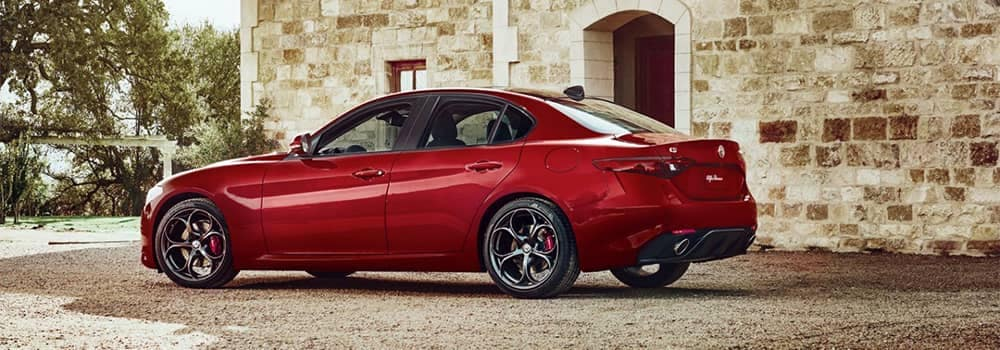 Alfa Romeo Giulia Parked Outside Brick Building