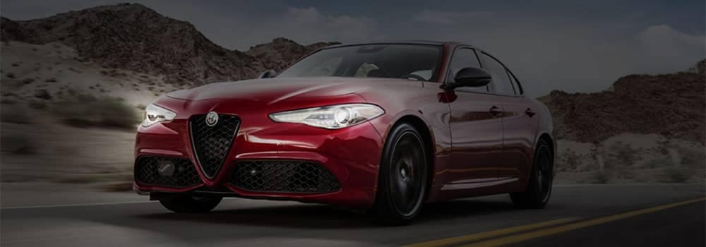 Alfa Romeo Giulia Driving at Night with Headlights