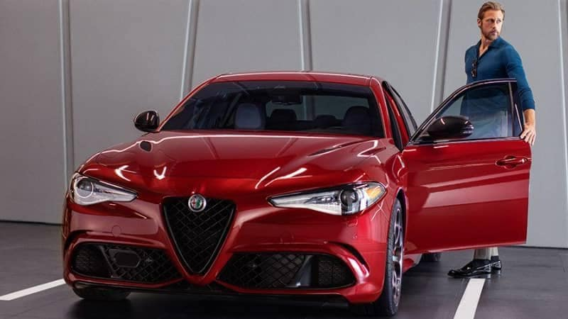 Man getting into a Alfa Romeo Giulia