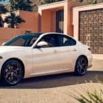 Alfa Romeo Giulia Parked in Front of House