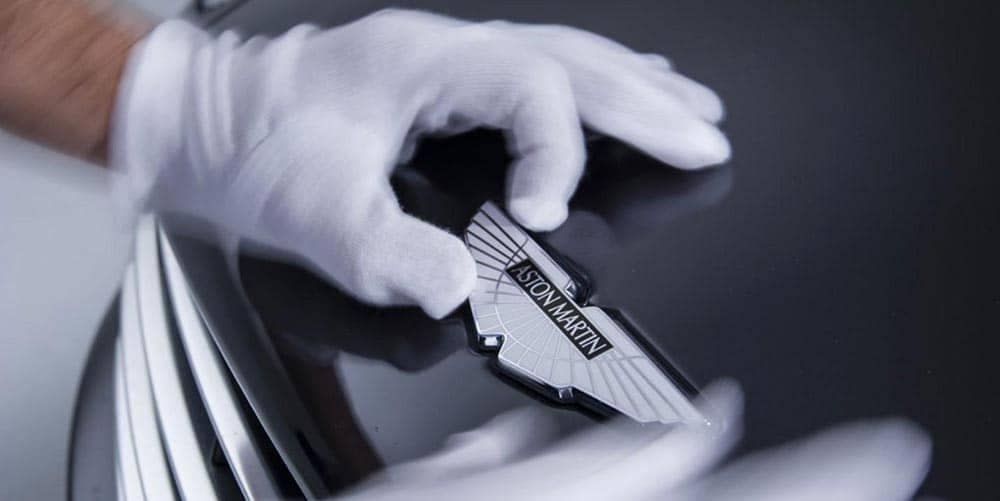 Aston Martin Badge with white glove service