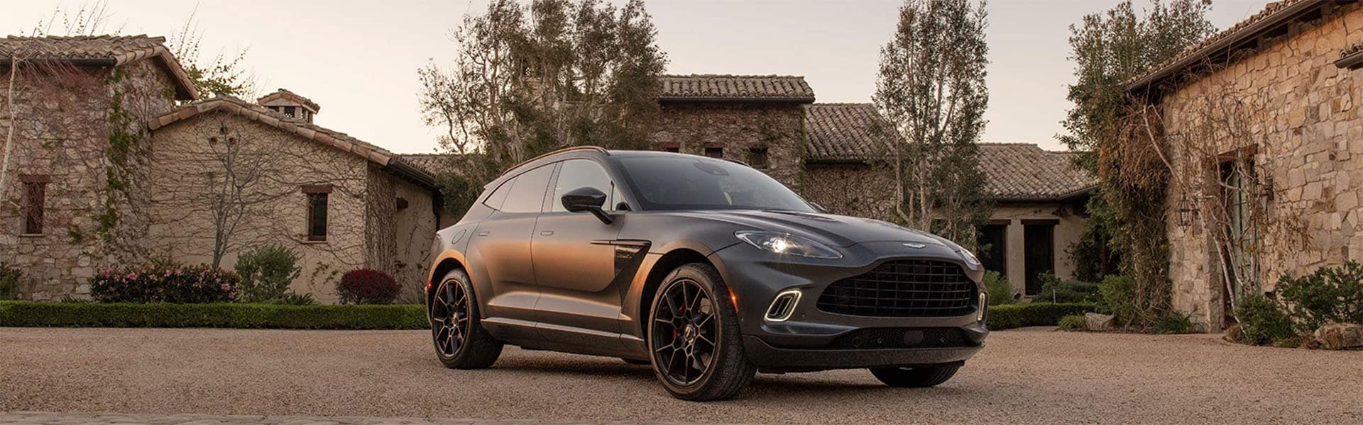 2021 Aston Martin DBX at sunset in front of a villa