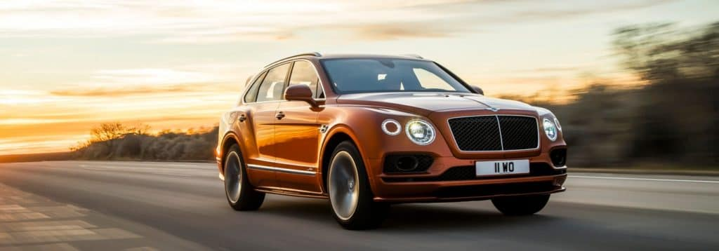 bentayga-speed-driving-on-road-in-sunset