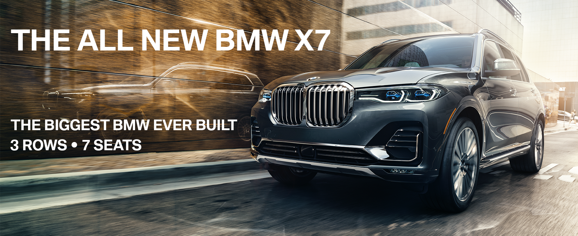All new BMW X7 in motion, overlay reads 'The all new BMW X7. The biggest BMW ever built. 3 rows, 7 seats.'