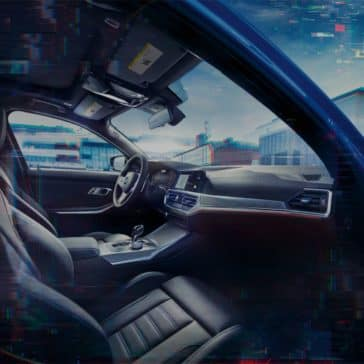 An interior photo of the 2019 BMW 3 Series, showing the passenger seat and cockpit.