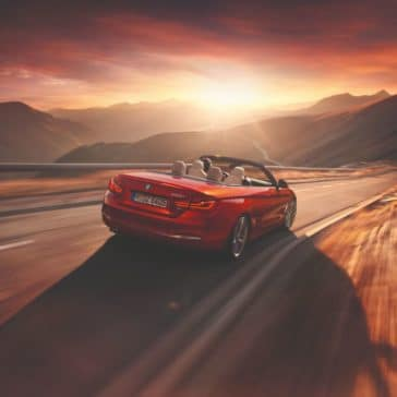 Photo of the 2019 BMW 4 Series Convertible driving along a highway.