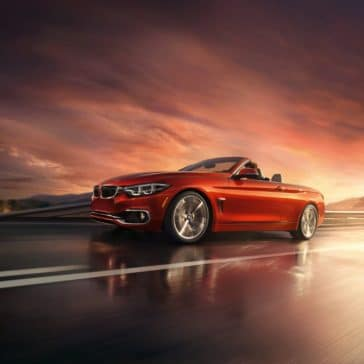 Front view of the 2019 BMW 4 Series Convertible driving along a highway.