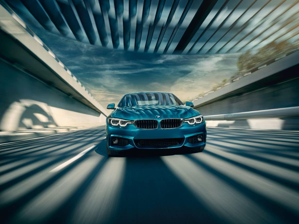A frontal view of the 2019 BMW 4 Series Coupe driving on a highway.