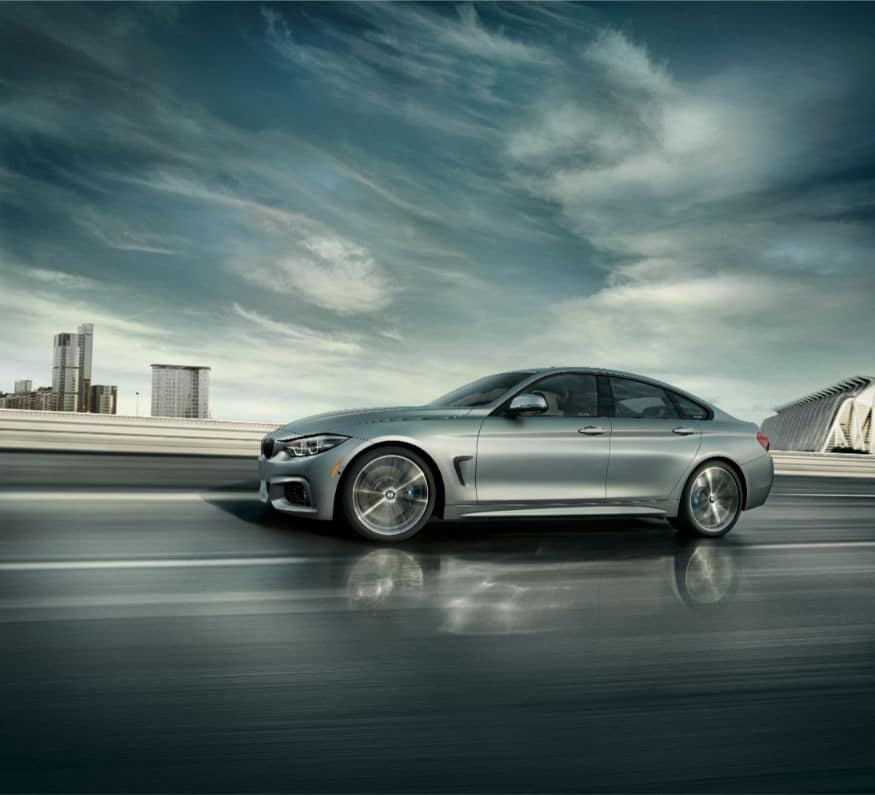 A side view of the 2019 BMW 4 Series Gran Coupe driving on a highway.