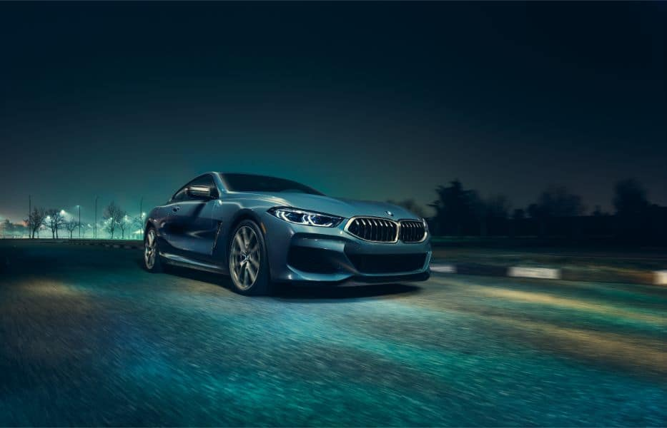 Front View of 2019 BMW 8 Series showcasing aggressive grille and front wheel.