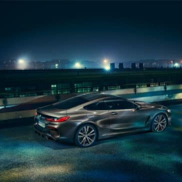 Aerial view of 2019 BMW 8 Series driving along a city skyline.