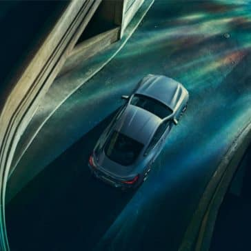 Aerial view of 2019 BMW 8 Series driving on a highway.
