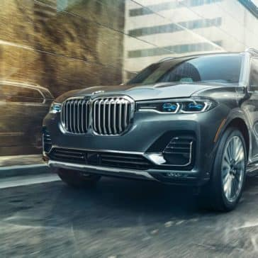 A frontal picture of the BMW X7 driving along an urban road.