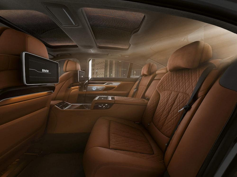 An interior picture of the 2019 BMW 7 Series showing the second row of seats and headrest entertainment.