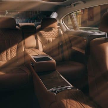 An interior photo of the BMW 7 Series showing the middle console and second row of seats.