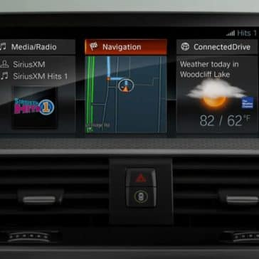 Interior photo of the BMW X3 showing the touchscreen navigation panel.
