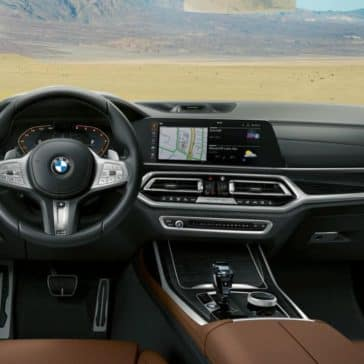 An interior picture of the BMW X7 showing the steering wheel and dashboard.
