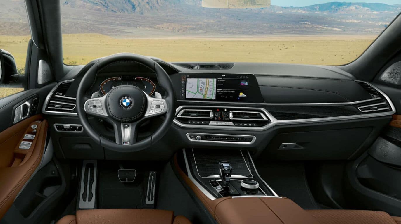 An interior picture of the 2019 BMW X7 showing the steering wheel and dashboard.