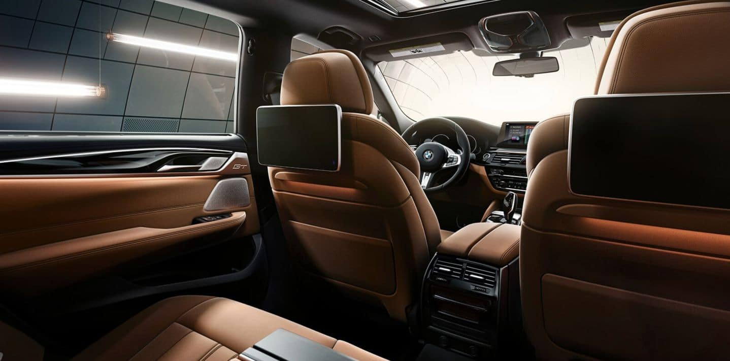 An interior photo of the BMW 6 Series showing the optional headrest entertainment screens.