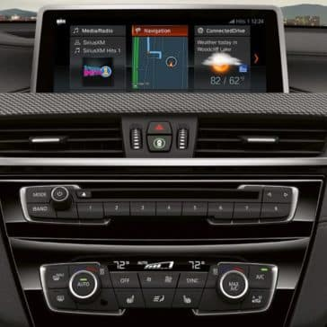 An interior picture of the 2019 BMW X2 showing the navigation pane and stereo.