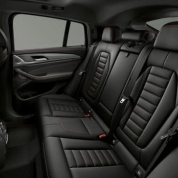 An interior picture of the 2019 BMW X4 showing the second row of seating.