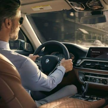 An interior picture of the 2019 BMW 7 Series showing a man driving.