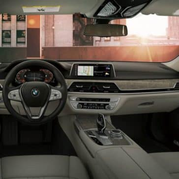 An interior picture showing the dashboard and front row of the 2019 BMW 7 Series.