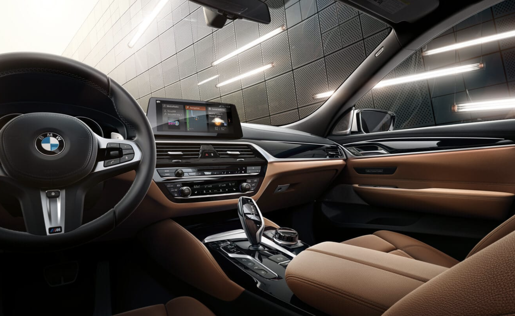 An interior shot of the BMW 6 Series showing the cockpit.