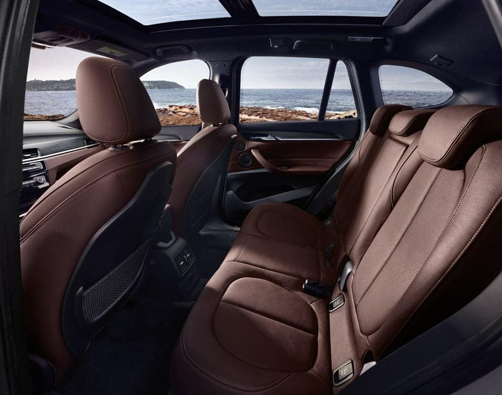 Showing the spacious rear row seating of the 2019 BMW X1 in Mocha Leather.