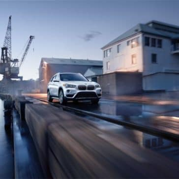 Zoomed out photo showing the 2019 BMW X1 in an urban setting.