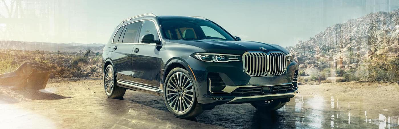 BMW X7 parked on a desert road
