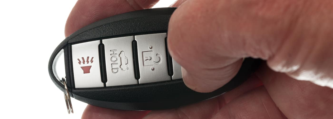 man finger on key fob