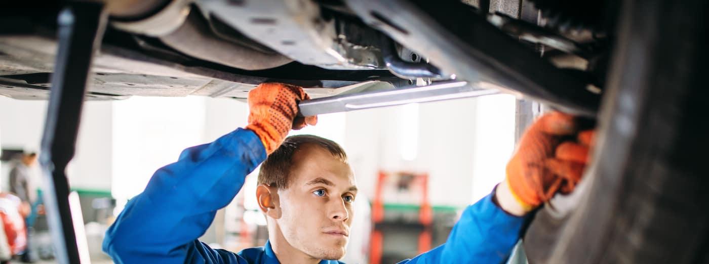mechanic working on suspension repair