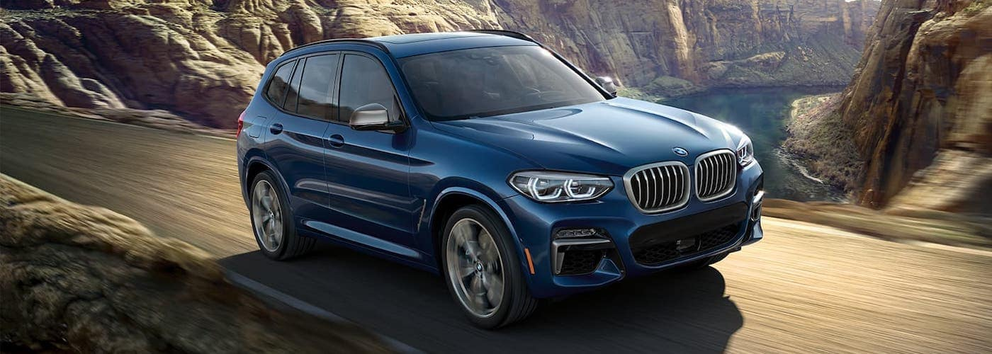 2020 bmw x3 blue on road
