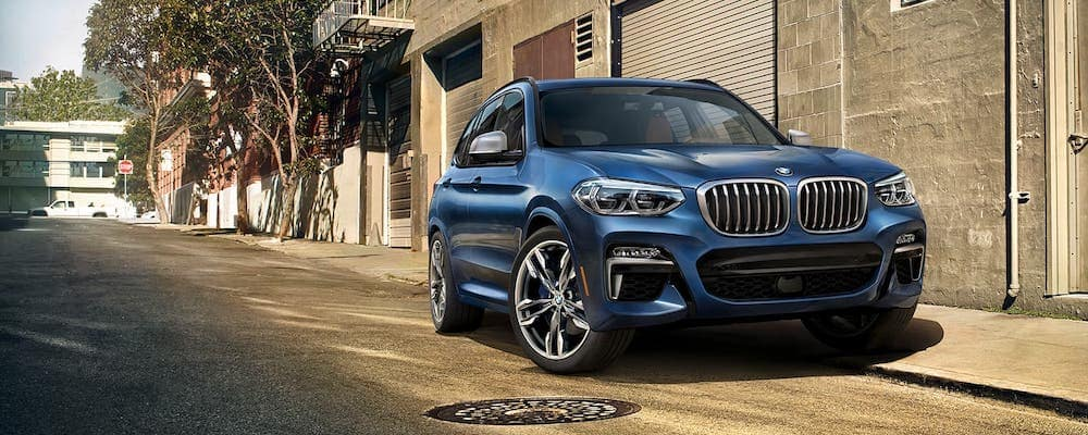 2020 bmw x3 blue exterior parked on street
