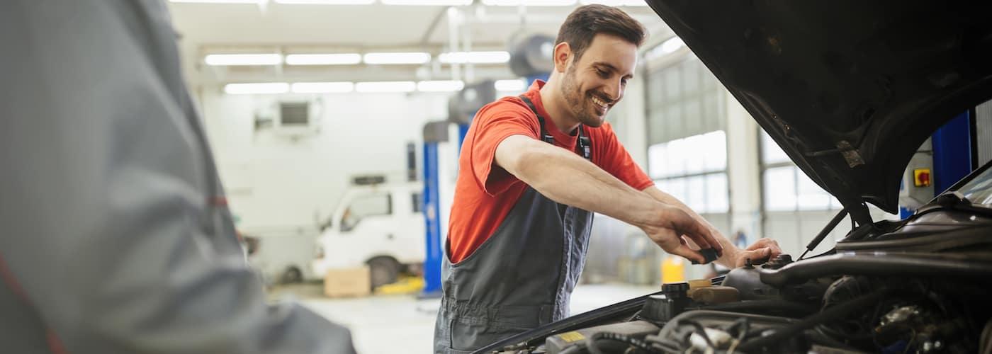 mechanic checking fluid levels