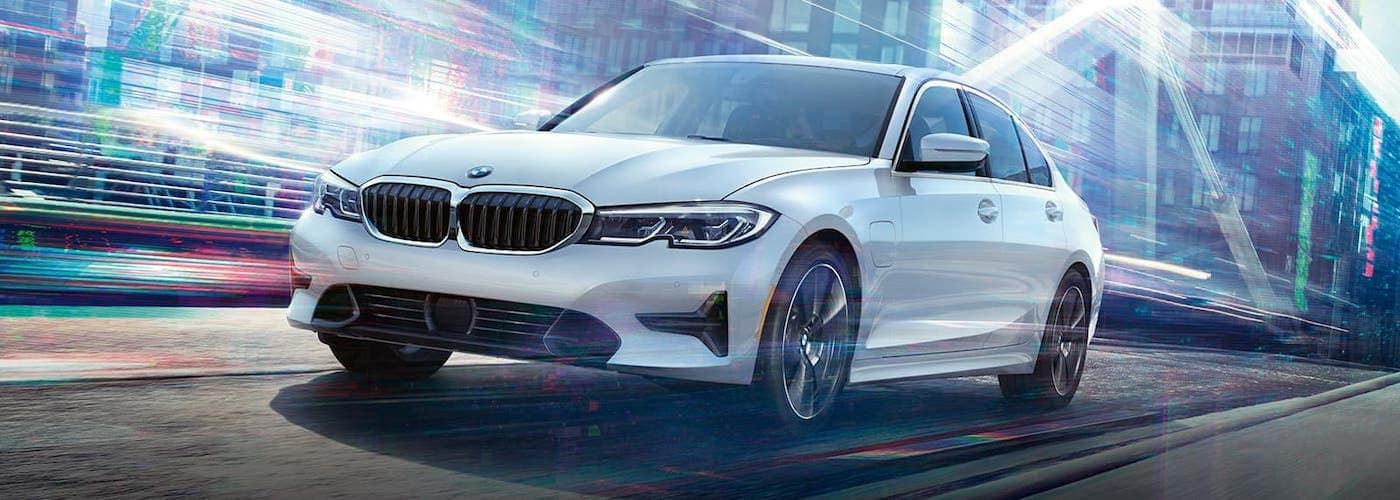 2020 bmw 3 series white exterior driving down road abstract lighting