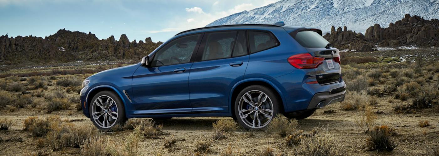 2020 bmw x3 activity sport blue exterior parked in desert backdrop