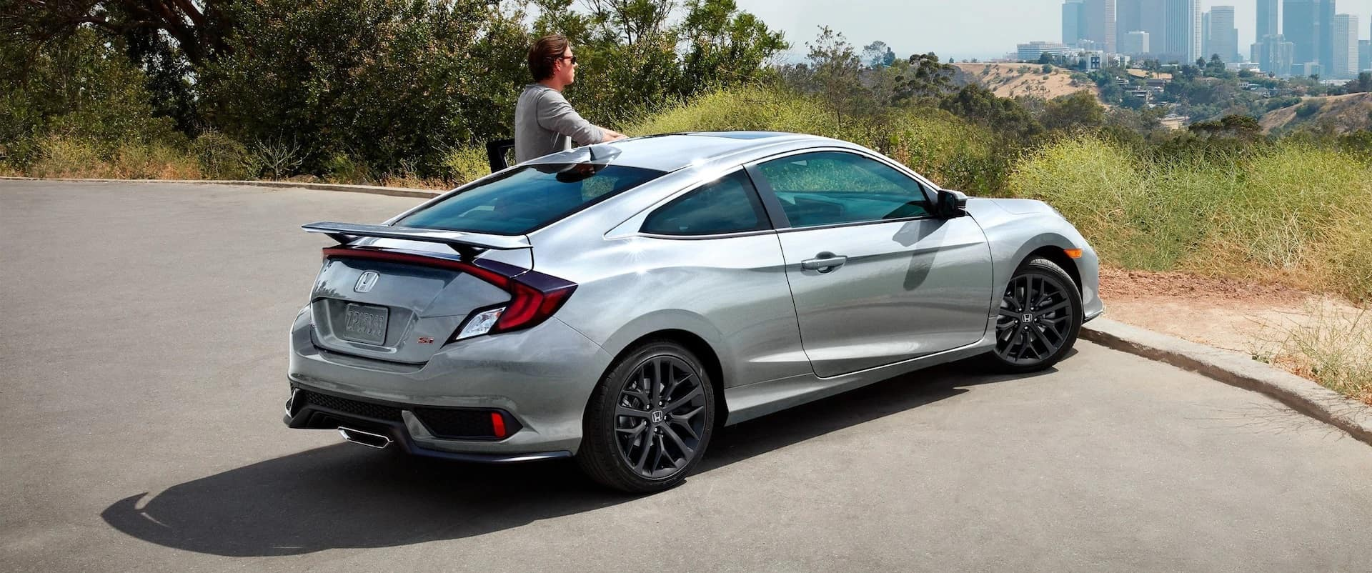 Honda_Civic_Si_SIlver_Parked_Outside_City