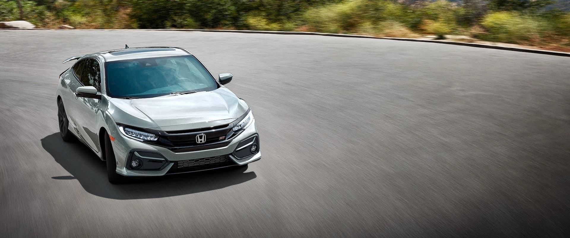Honda_Civic_Si_Silver_Driving_Country_Road