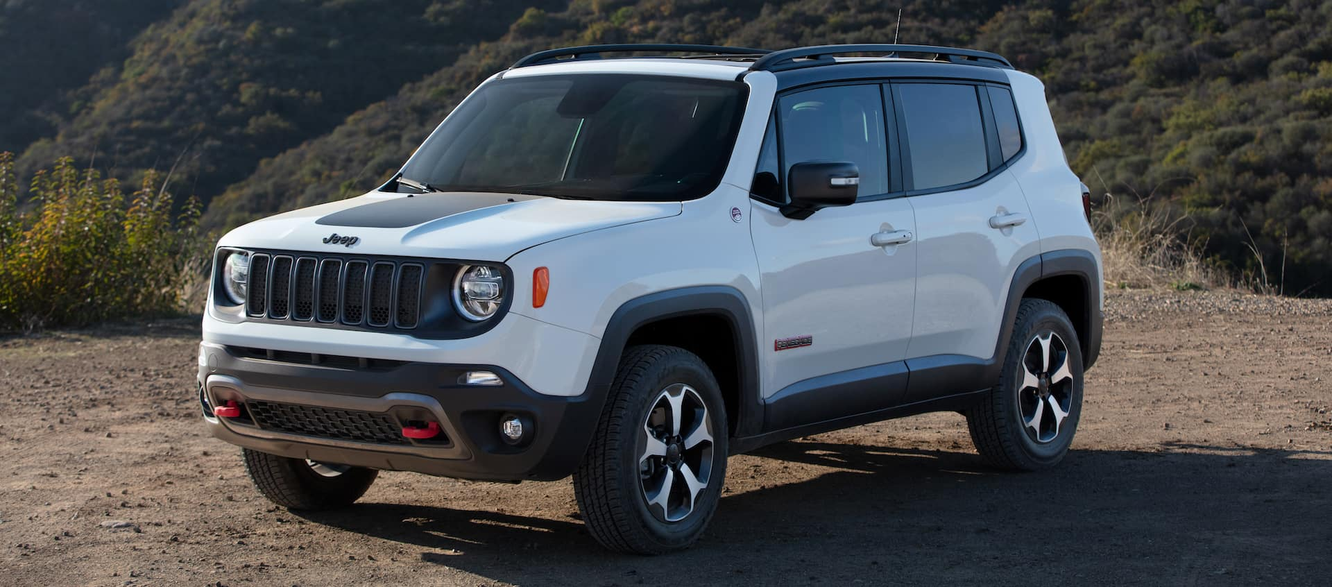 Compare the 2021 Jeep Renegade and the 2021 Chevrolet Equinox at Carolina CDJR in Elizabeth City, NC | 2021 Jeep Renegade parked on trail