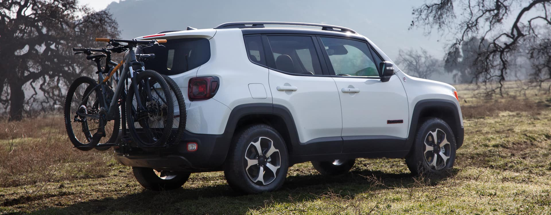 Compare the 2021 Jeep Renegade and the 2021 Chevrolet Equinox at Carolina CDJR in Elizabeth City, NC | 2021 Jeep Renegade parked with bikes on the back