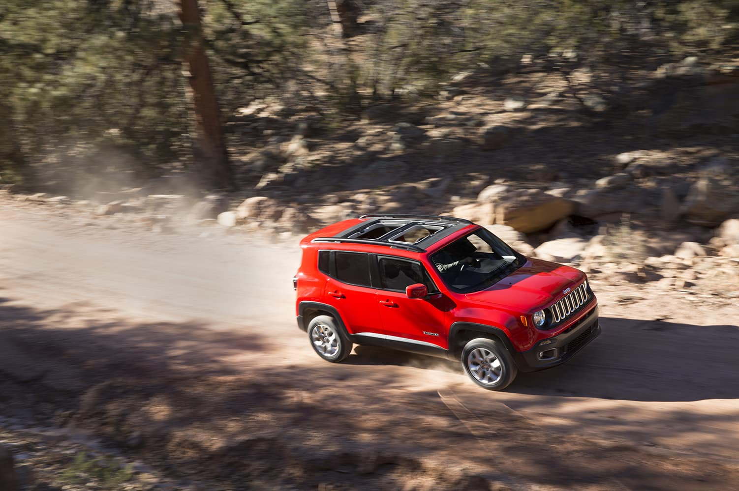 Compare the 2021 Jeep Renegade and the 2021 Chevrolet Trailblazer at Carolina CDJR in Elizabeth City, NC | 2021 Jeep Renegade driving on dirt trail