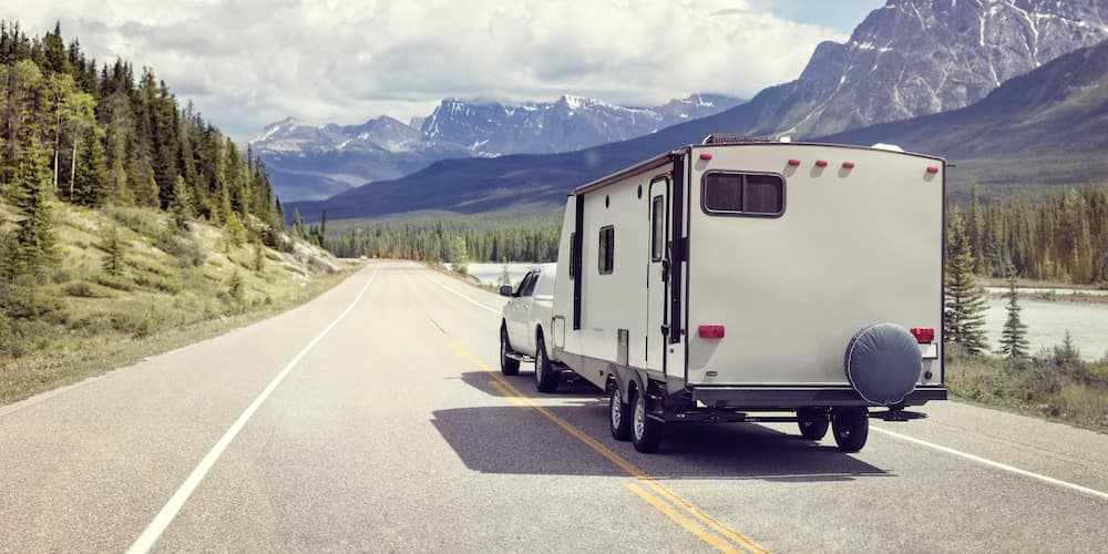 Truck Towing an RV into the Mountains