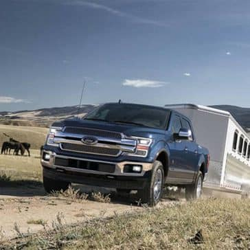 2019-Ford-F-150-Towing-a-Trailer-on-Dirt-Road