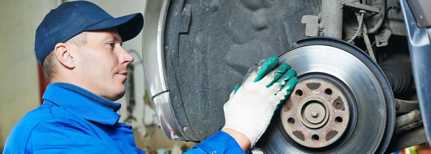 mechanic working on suspension repair close up