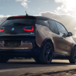 2020 bmw i3 brown exterior driving down deserted road