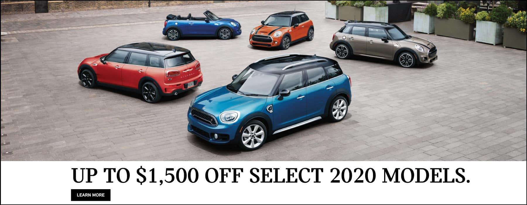 Up to $1,500 off select 2020 models. Family of MINI's parked in front of buildings.